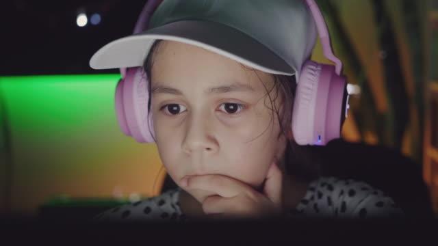 close up shot of girl staring at laptop screen - staring stock videos & royalty-free footage