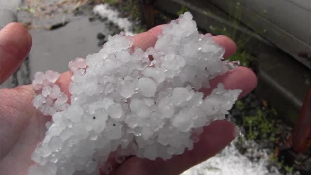 Close up shot of handful of hail captured at 420 pm in Nakatomatsuri town Utsunomiya