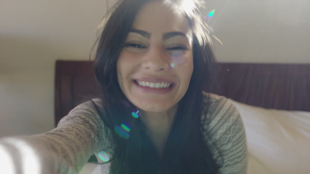 close up shot of happy woman waving on video chat / escalante, utah, united states - escalante stock-videos und b-roll-filmmaterial