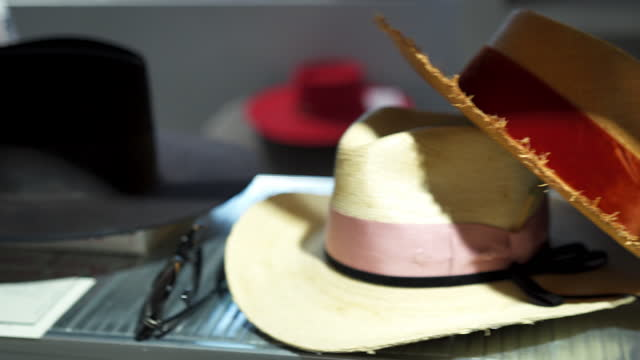 close up shot of hats sitting on a shelf in a clothing store - small group of objects stock videos & royalty-free footage