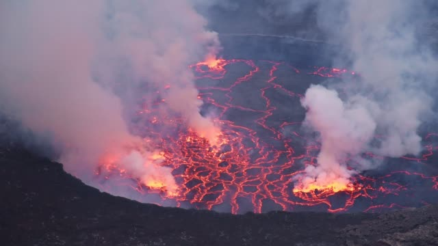 close up shot of lava lake in in the crater of active volcano nyiragongo full of smoke - land stock videos & royalty-free footage