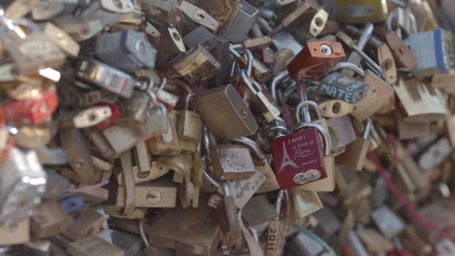 Close up shot of 'love locks' attached to the Pont des Arts bridge in Paris, France
