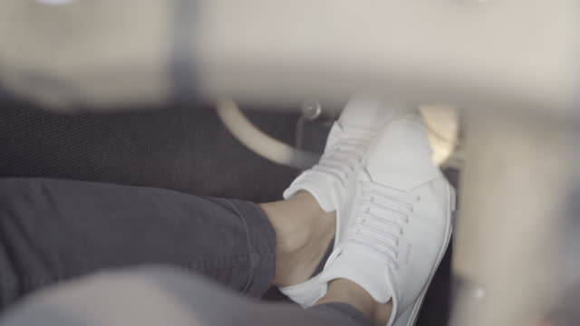 close up shot of male feet driving in a car - brake stock videos & royalty-free footage