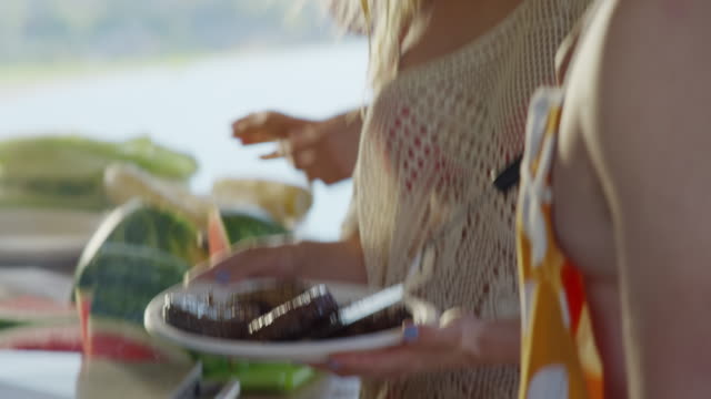 close up shot of man placing hamburgers on plate for barbecue / cedar hills, utah, united states - underwear stock videos & royalty-free footage