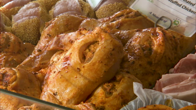close up shot of marinated and stuffed chicken - marinated stock videos & royalty-free footage
