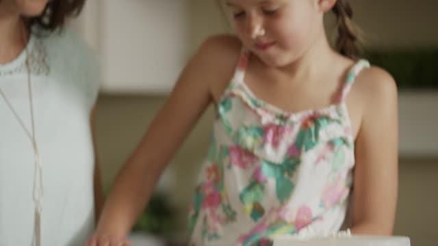 close up shot of mother and daughter baking / orem, utah, united states - orem video stock e b–roll