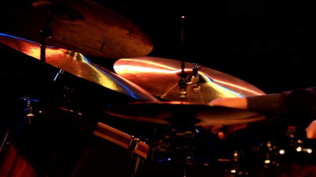 close up shot of musician playing drums