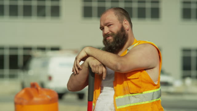 close up shot of overweight construction worker flirting / lehi, utah, united states - bauarbeiter stock-videos und b-roll-filmmaterial