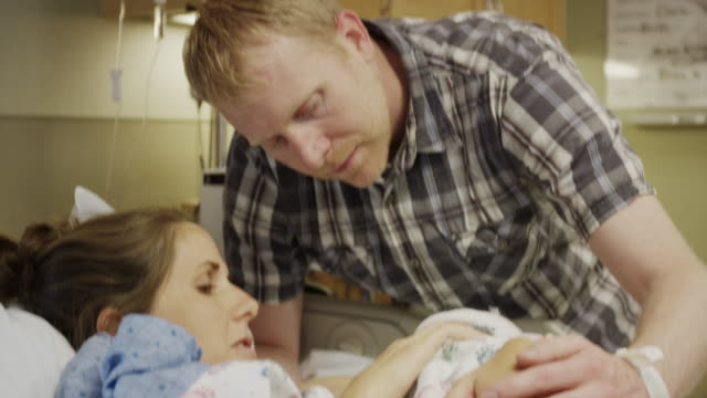 Close up shot of parents admiring newborn baby in hospital / Midvale, Utah, United States