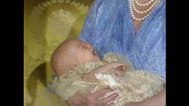 close up shot of prince william crying while being held by the queen mother during a photoshoot on the day of his christening. - international landmark stock videos & royalty-free footage