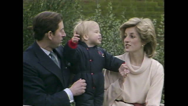 close up shot of princess diana, prince charles and 18-month old prince william during a press photo call at kensington palace gardens. - toddler stock videos & royalty-free footage