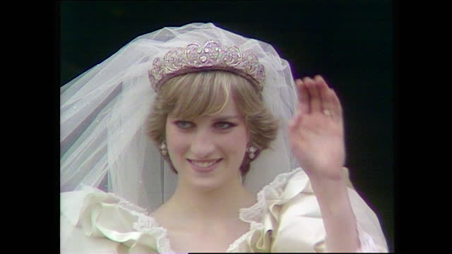 close up shot of princess diana waving from the buckingham palace balcony on the day of her wedding; 1981. - wife stock videos & royalty-free footage