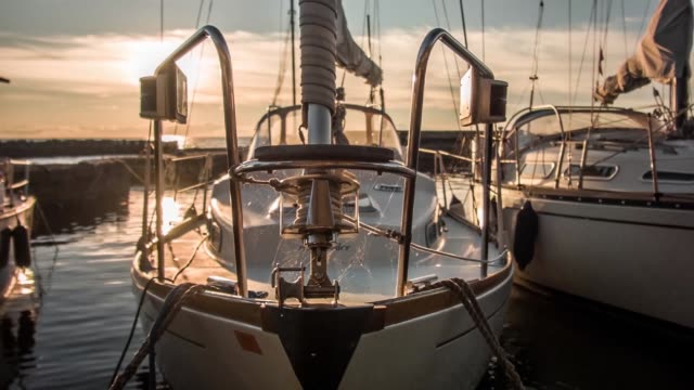 close up shot of sailboats in a harbor in denmark at sunset - moored stock videos & royalty-free footage