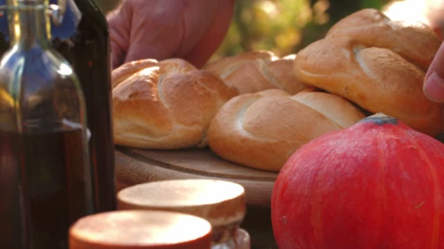close up shot of senior man serving fresh, homemade buns - serving food and drinks stock videos & royalty-free footage