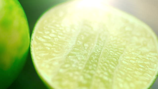 close up shot of sliced lime. - lemon fruit stock videos & royalty-free footage