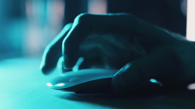close up shot of someone using a smart computer mouse at a desk in a home office at night on april 06, 2020 in bristol, uk. - computer network stock videos & royalty-free footage