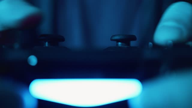 close up shot of someone using a video games console controller while playing games at home on april 13, 2021 in bristol, uk. - hobbies stock videos & royalty-free footage