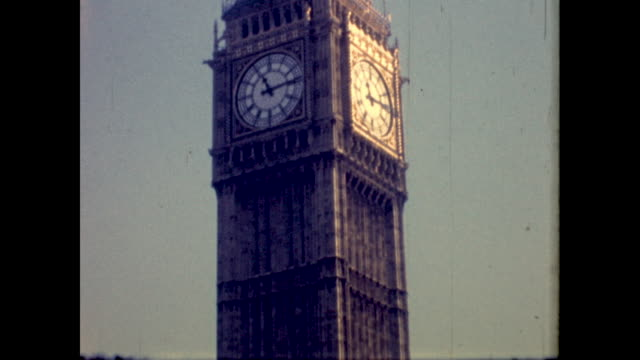 close up shot of the clocktower of big ben; red bus passes in the foreground - city of westminster london stock videos & royalty-free footage