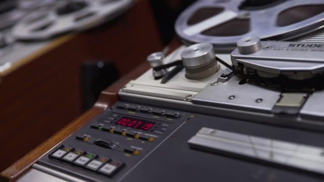 Close up shot of the digital display and controls of a 'Struder' reel to reel film