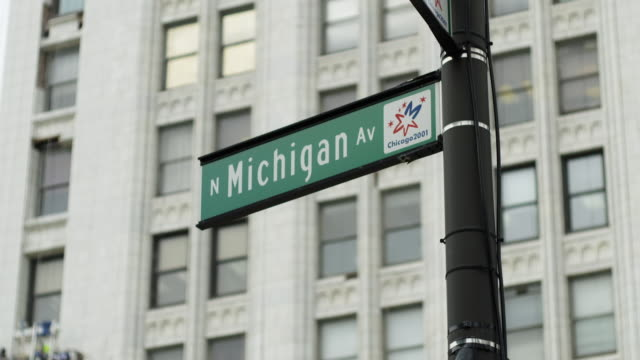 close up shot of the michigan avenue street sign in chicago - michigan avenue chicago stock videos & royalty-free footage