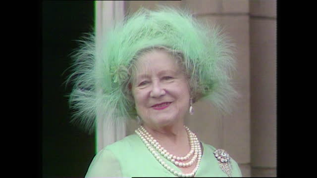 close up shot of the queen mother smiling as she stands on the buckingham palace balcony on the day of the wedding of prince charles and lady diana... - smiling stock videos & royalty-free footage