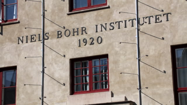 close up shot of the sign on the front of the niels bohr institute in copenhagen. for years, niels bohr worked in humble conditions at the university... - denmark stock videos & royalty-free footage