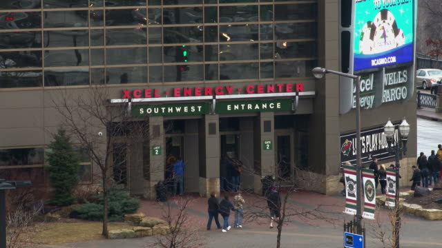 A close up shot of the Xcel Energy Center in St. Paul Minnesota showing fans entering the building