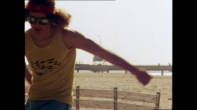 close up shot of tony alva, a professional skateboarder, skateboarding by venice beach; 1978. - young men stock videos & royalty-free footage