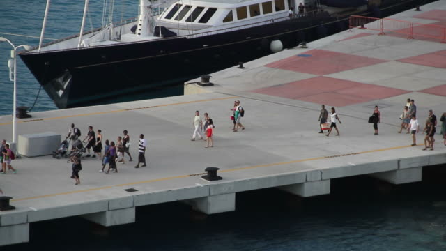 close up shot of tourists getting on a cruise ship in saint marteen - tourism stock videos & royalty-free footage