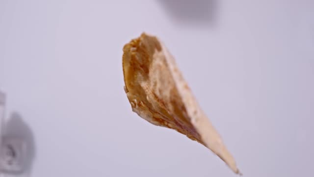 slo mo close up shot of turning a pancake - lanciare video stock e b–roll