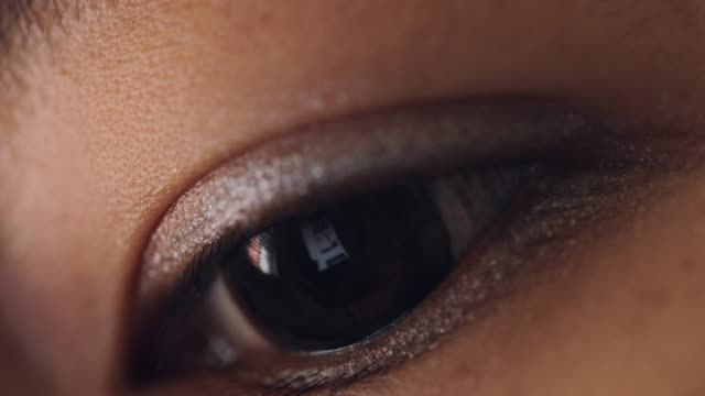 close up shot of woman eye surfing internet at room - hypnosis stock videos and b-roll footage