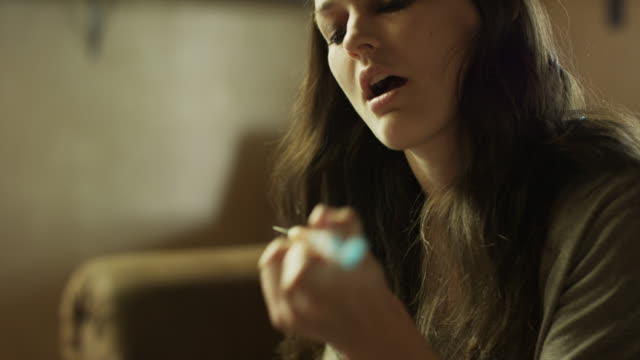 close up shot of woman injecting arm with syringe / springville, utah, united states - drogmissbruk bildbanksvideor och videomaterial från bakom kulisserna