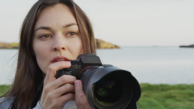 close up shot of woman photographing near river / borgarnes, iceland - only mid adult women stock videos and b-roll footage