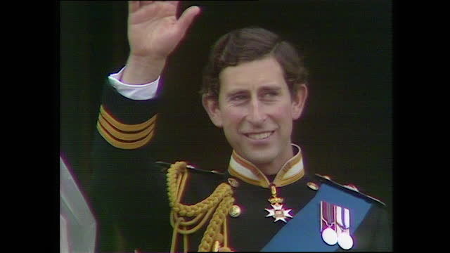 close up shot panning from princess diana to a waving prince charles as they stand on the buckingham palace balcony; 1981. - wife stock videos & royalty-free footage