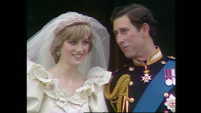 close up shot panning up from prince charles and princess diana holding hands to the couple talking and smiling to each other as they stand on the... - balcony stock videos & royalty-free footage