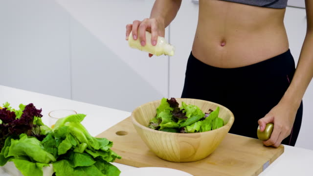 close up shot, young asian sporty woman is cooking and preparing salad in kitchen, healthy food concept - salad dressing stock videos & royalty-free footage