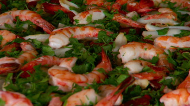 close up shots of a beautifully presented platter of cooked peeled prawns/shrimp with parsley - parsley stock videos and b-roll footage