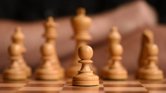 Close up shots of a chess board focus on a pawn piece moving and capturing other pieces shot on July 2nd 2015 Shots Close up shot of a player sliding...