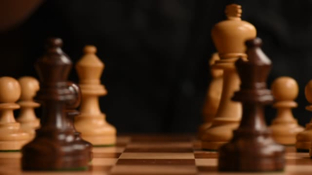 stockvideo's en b-roll-footage met close up shots of a chess board show a king piece on it's side rolling back and forth shot on july 2nd 2015 shots shots of a player turning the white... - schaakstuk