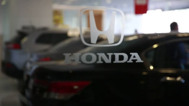 Close up shots of a Honda logo on the glass door entrance to a Honda dealership in Mexico City Mexico on January 14th 2016 Photographer Susana...