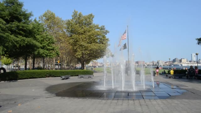 close up shots of a plaque honoring frank sinatra at frank sinatra memorial park in hoboken, new jersey, wide shots of a public fountain along the... - manhattan video stock e b–roll
