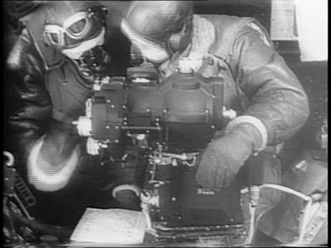stockvideo's en b-roll-footage met close up shots of bombardiers using the norden bombsight to hone in on a target / shots of plane releasing clusters of bombs from the belly of the... - pilot