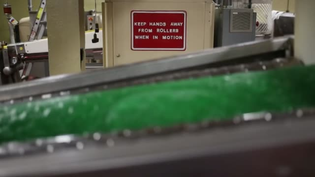 close up shots of buckets of sugar used to make dum dum lollipops during the manufacturing process at spangler candy company's facility in bryan,... - plant process stock videos & royalty-free footage