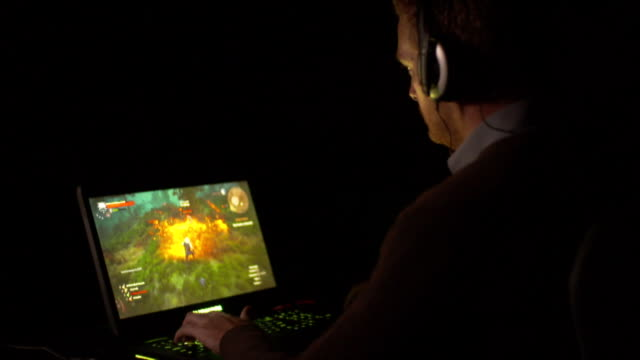 Close up shots of competitors playing online video games and action on screen during New Zealand Gaming Championships tournament in Auckland