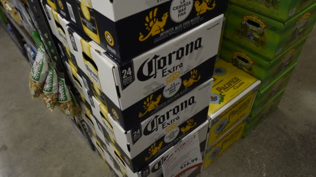 Close up shots of Constellation Brand alcohols in a liquor store in San Francisco California on April 7th 2015 Shots Six Packs of Corona beer sit on...