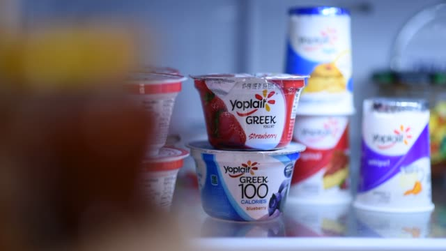 Close up shots of General Mills' Yoplait Yogurt food products stacked inside a refrigerator in Tiskilwa Illinois A container of Yoplait Yogurt sits...