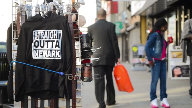 close up shots of sweatshirts hanging outside a store with the slogan straight outta newark printed on them in downtown newark new jersey on march... - sweatshirt stock videos & royalty-free footage