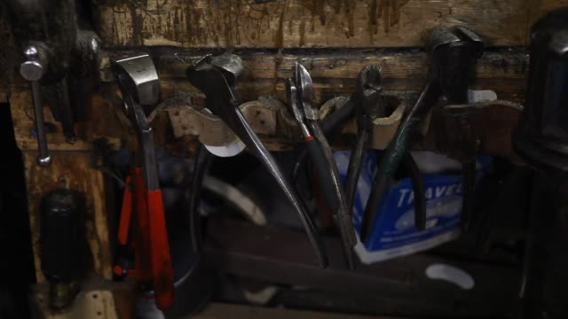 close up shots of tools scattered around a shoe repair workbench in the basement of jim's shoe repair shop on 59th street in new york ny close up... - workbench stock videos & royalty-free footage