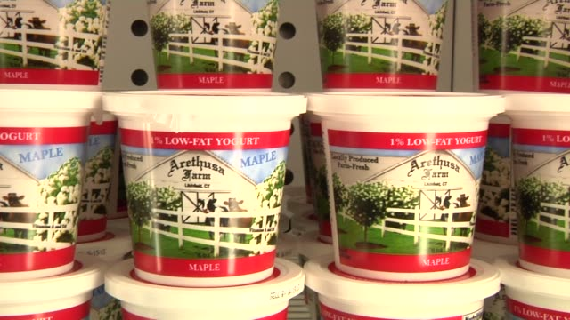 vidéos et rushes de close up shots of various arethusa farm products in storage in their warehouse in bantam connecticut including ice cream yogurt cheese and plain milk - salle de traite