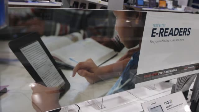 close up shots of various ereaders for sale at a best buy in northbrook illinois rak focus shots of a kindle logo on an ereader device shots of... - electronic book stock videos & royalty-free footage
